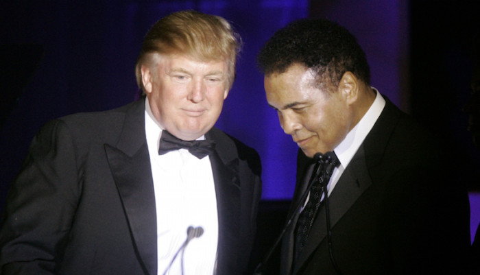 Donald Trump, left, accepts his Muhammad Ali award from Ali at Muhammad Ali's Celebrity Fight Night XIII in Phoenix, Ariz., Saturday, March 24, 2007. (AP Photo/Jeff Chiu)